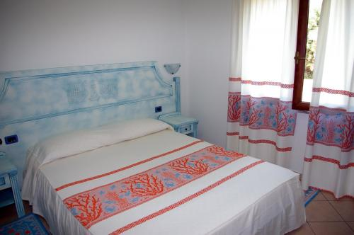 Double bed room of a Residence in Arbatax