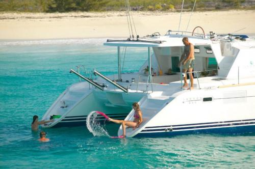 Family aboard a catamaran and in the water in the La Maddalena Archipelago