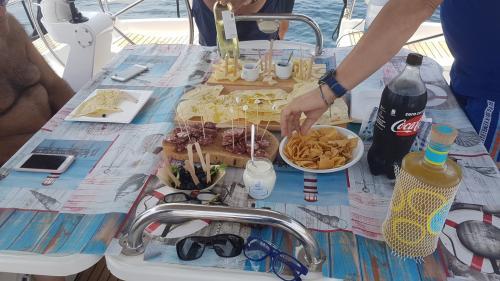 Table set for an aperitif on board a catamaran in the La Maddelana Archipelago