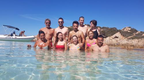 Group photo during a catamaran excursion in the La Maddalena Archipelago