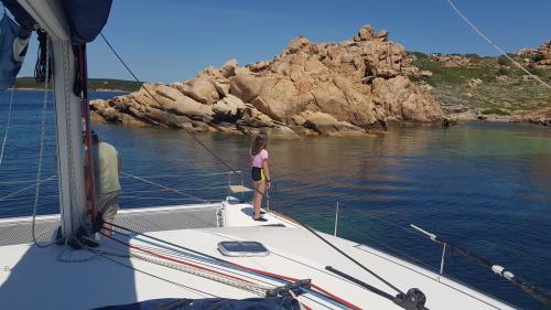 Little girl on board a catamaran in the La Maddalena Archipelago