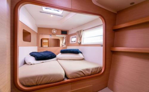 Bedroom of a catamaran in the waters of the La Maddalena Archipelago