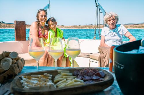 Family during Sardinian aperitif served aboard a sailing boat