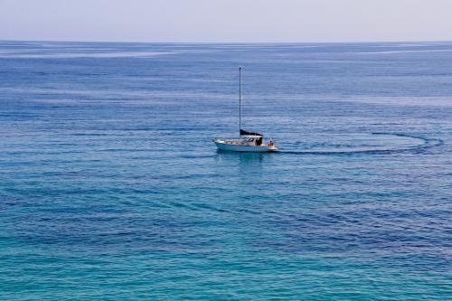 Sailboat sailing in northern Sardinia
