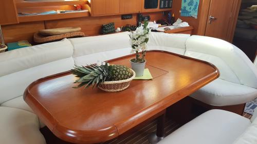 Dining table, living room inside a sailing boat in Santa Teresa di Gallura