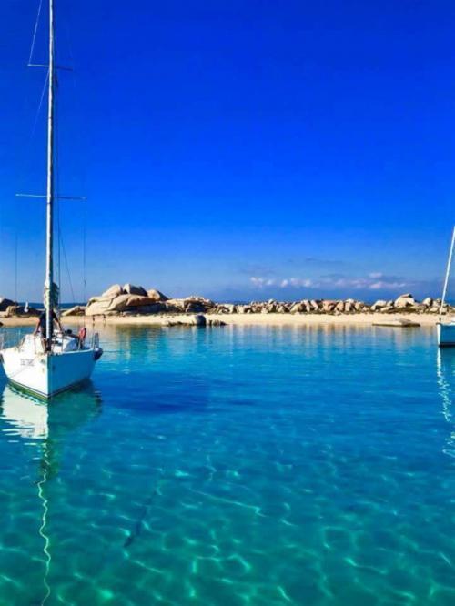 Sailboat in the sea of Santa Teresa di Gallura