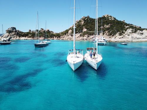 Sailboats in the sea of the La Maddalena Archipelago