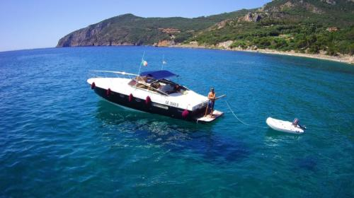 Motor boat and tender to reach the beaches in the La Maddalena Archipelago