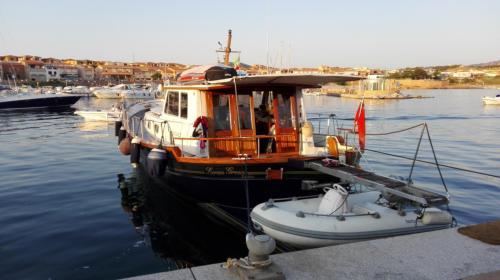 Motor boat docked in Porto Rafael in Palau