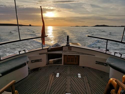 Sunset Archipelago of La Maddalena during motor boat tour