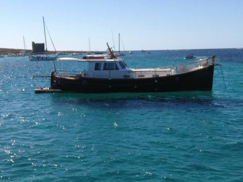 Motor boat sailing in the La Maddalena Archipelago