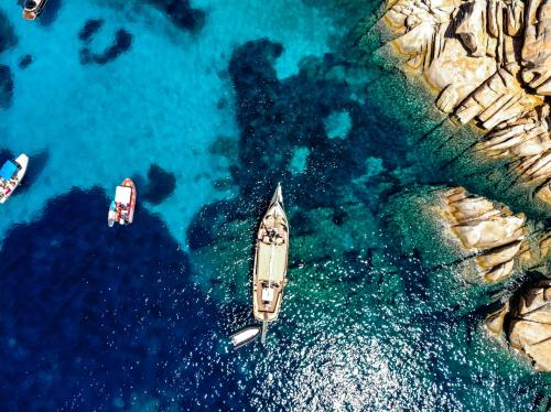 Vintage sailing ship between the islands and the crystal clear sea
