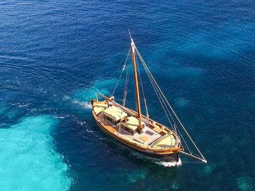 Vintage sailing ship among the transparent waters