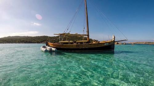 Vintage sailing ship in the crystal clear sea